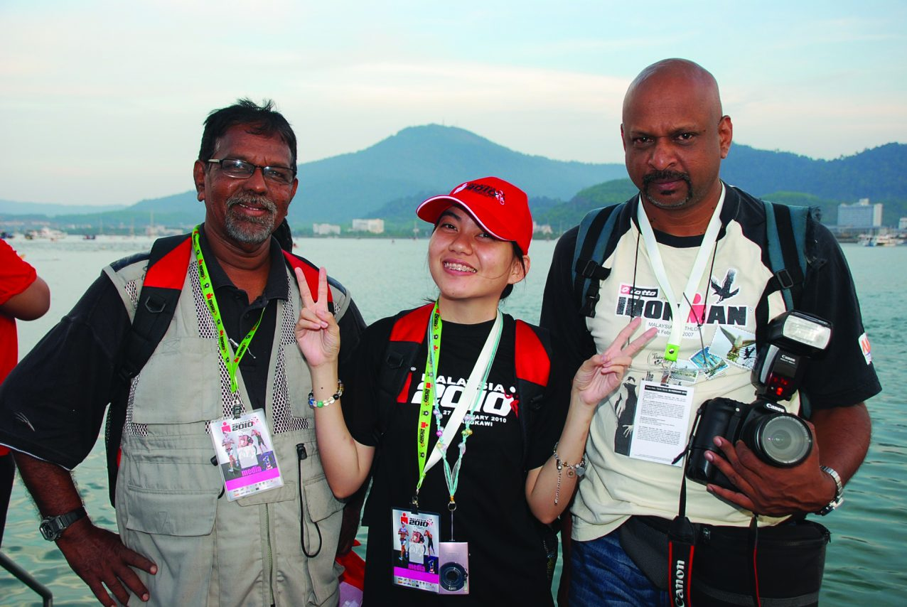 Picture of Challenges disability journalist Helen Lam with peer colleagues covering Ironman Langkawi