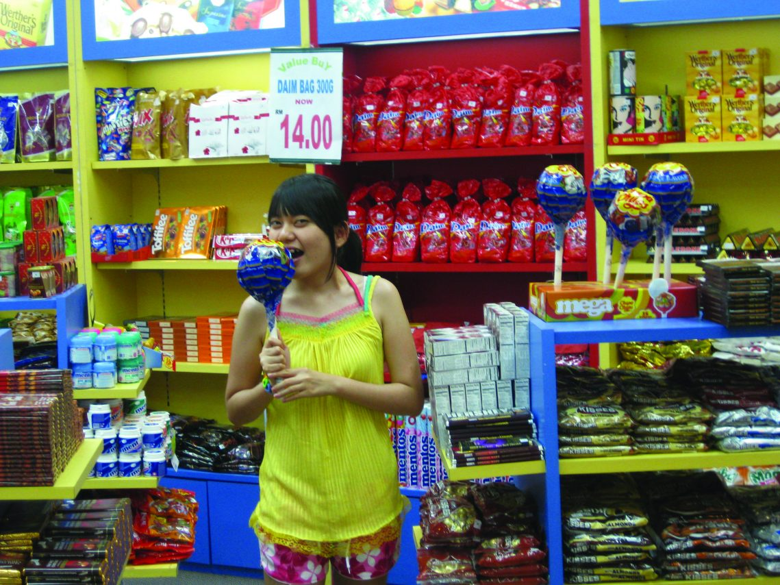 Picture of Helen Lam shopping for chocolates