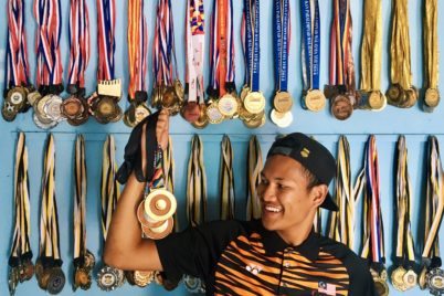 Muhamad Ashraf with his medals