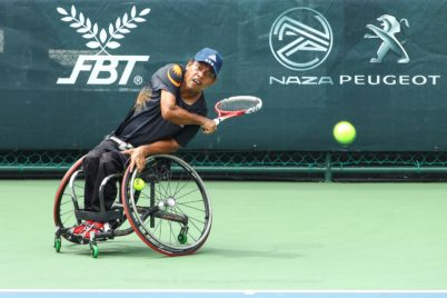 Photo of wheelchair tennis player in action