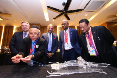 Prof Dato Wan Azman Wan Ahmad demonstrating on a simulator how a drug coated balloon is inserted into a patient's heart. Looking on is (from left) Prof Bruno Scheller, Mr Pallraj Arumugam, Dr Muhamad Ali Sheikh Abdul Kader and Datuk Dr Rosli Mohd Ali.
