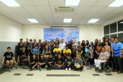 group photo of participants at the wheelchair tennis programme at UM